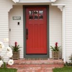 craftsman style front door grass flowers whitw wall red door traditional entry