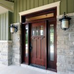 craftsman style front door lamps stone wall wood elegant entry