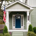 craftsman style front door plants flag stairs entry area