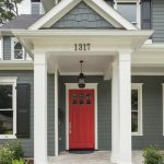 craftsman style front door plants windows lamp traditional entry red