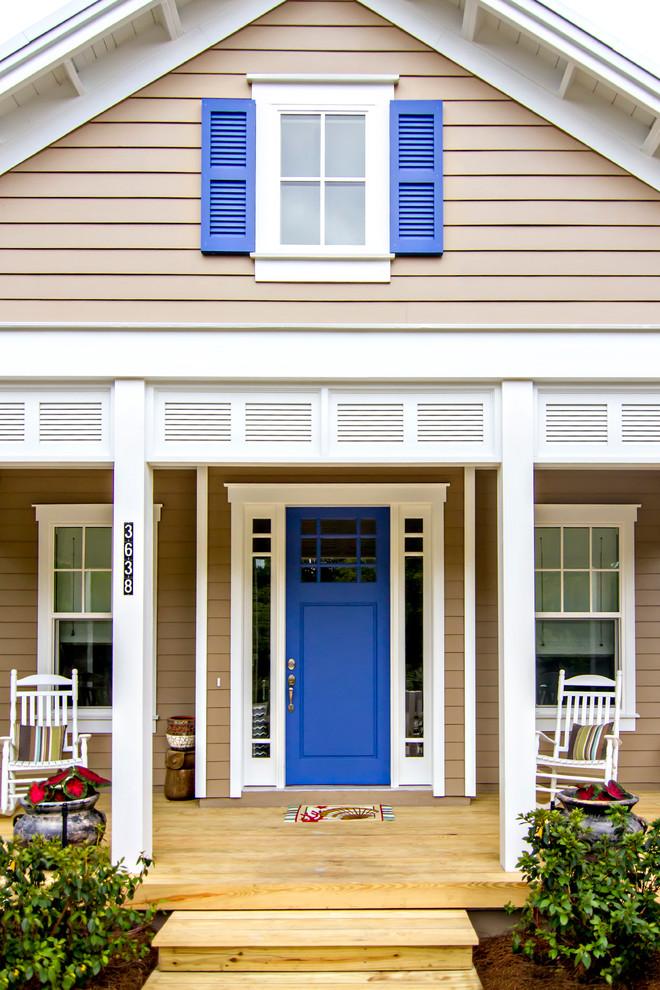 craftsman style front door rocking chairs windows wood floor beach style porch