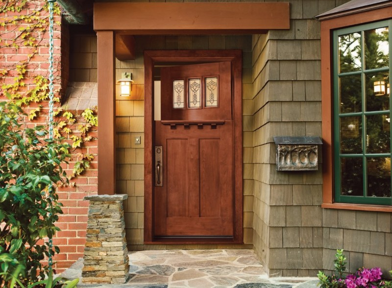 craftsman style front door stone floor bricks window decorative plants lamp rustic entry