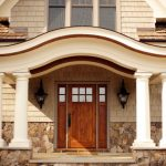 craftsman style front door stones pillars windows lamps traditional entry