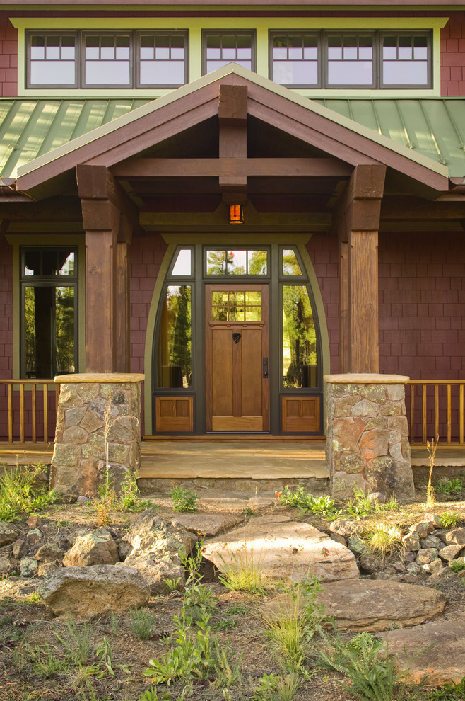 craftsman style front door stones windows railing entry area