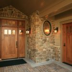 craftsman style front doors stone walls lamps bench window