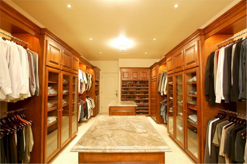 craftsman walk in closet with glass door shelves and hang sections marble top center islands white ceramic floors