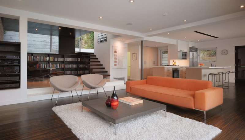 cream chairs orange sofa white rug medium toned wooden floor white painted kitchen cabinet bar stools wooden coffee table
