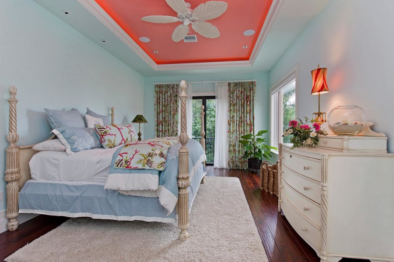 custom bedding idea in light blue classic style bed frame with four pillars white area rug white console table dark toned woodboard floors pink ceilings