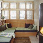 daybed for living room bookshelves standard fireplace column windows throw pillows beige floors rustic design