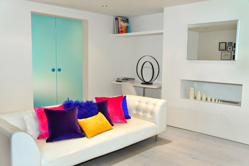 daybed for living room built in shelves colorful throw pillows beige floors double turquoise doors ceiling lights contemporary design