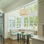 dining booth for home bench glass top table hardwood floors chandelier bay windows throw pillows traditional design