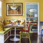 Dining Booth For Home Patterned Bench Table Chairs Pendants Hardwood Floor Framed Painting Yellow Walls Eclectic Design