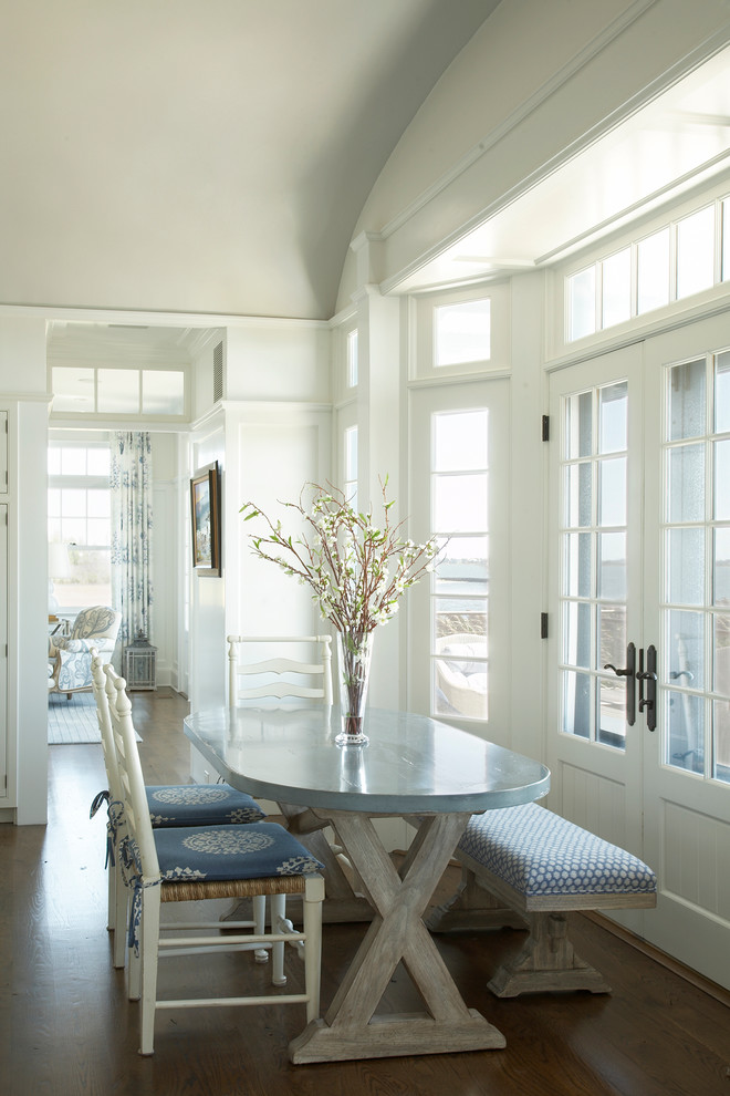 dining room table with bench and chairs flowers windows curtain beach style area