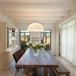 dining room table with bench and chairs flowers windows lamp contemporary style