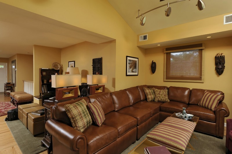 elegant traditional living room with sectional sofa pillows carpet ottoman cool lamps table wall decors