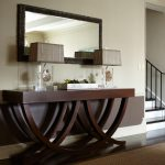 entryway table hardwood floors rug lamps staircase mirror contemporary design