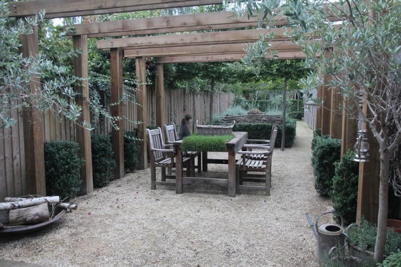 farmhouse backyard patio with wooden pergola wooden furniture for patio gravel floors