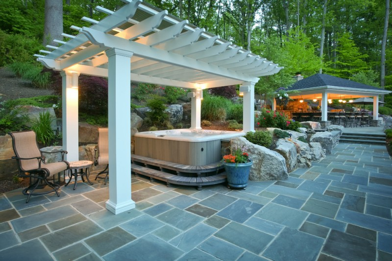 fiberglass made pergola hot tub a couple of chairs with side table