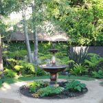 Front Yard Fountain Pool Stone Paver Ceramic Pots Garden Plants Mediterranean Design