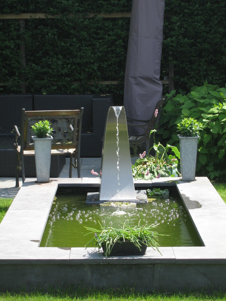 front yard fountains chairs stone walls plant pots contemporary design