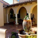 front yard fountains pedestal base urn garden lamp pillars beige walls windows pots mediterranean design