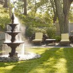 front yard fountains pond chairs table fence garden stone walls traditional design