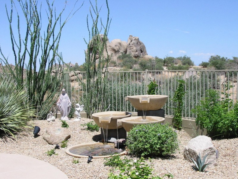 front yard fountains stone plants metal fence sculpture urns southwestern design