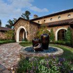 Front Yard Fountains Stone Walls Pavers Roofs Windows Garden Flowers Plants Sconces Urns Mediterranean Design