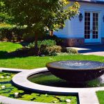 front yard fountains urn garden layered pond doors white wall sconces traditional design