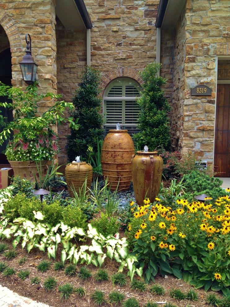 front yard fountains wall lamp garden door plants flowers window stone walls mediterranean design