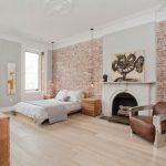 hanging lights in bedroom brick wall hardwood floor sidetables armchair lamp cabinet fireplace artwork scandinavian design