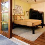 Hanging Lights In Bedroom Ceiling Fan Double Bed Artwork Dark Cabinet Hardwood Floors Carpet Glass Door Tropical Design