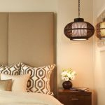 hanging lights in bedroom double bed sidetable pillows headboard flower vase contemporary design
