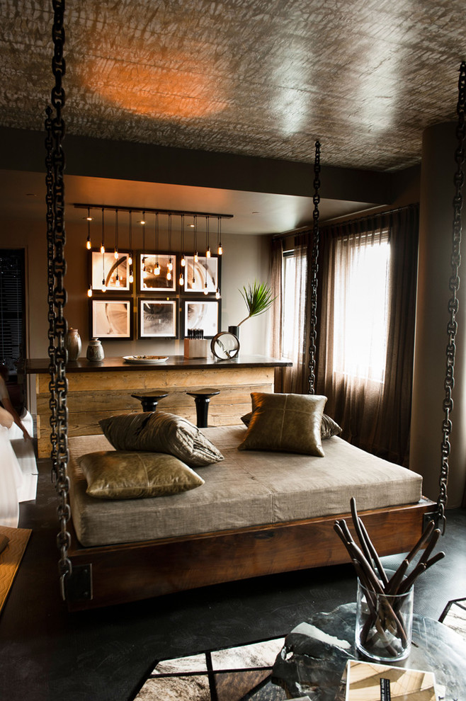 hanging lights in bedroom four post bed pillows framed paintings window sidetable hardwood floors decorations industrial design