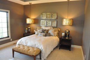hanging lights in bedroom ottoman sidetables dark walls carpeted floors single bed pillows window urns craftsman design