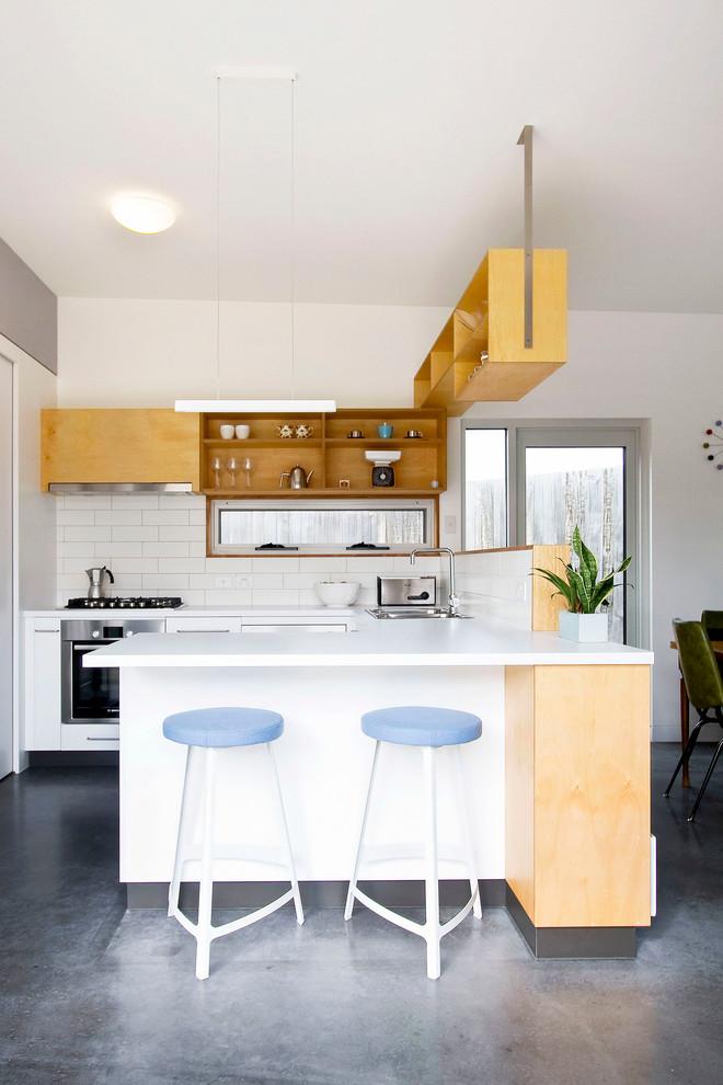 hanging shelves from ceiling stools upper cabinet kitchen island pendant concrete floors sink subway tile backsplash contemporary design