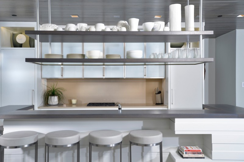 hanging shelves from the ceiling stools books dark countertop stove decorative plant wall cabinets contemporary kitchen