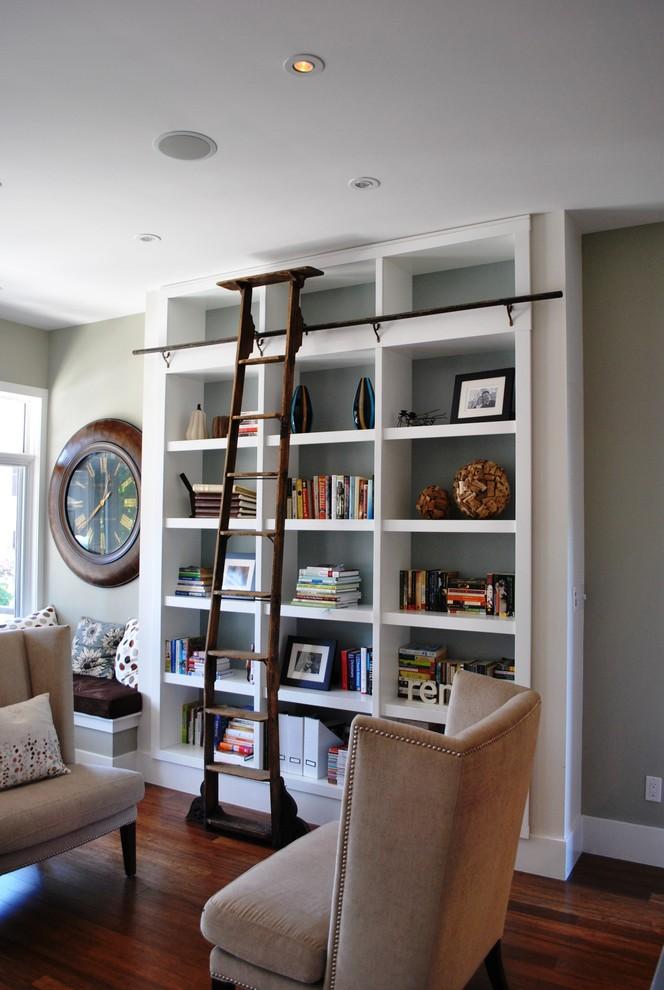 home library shelving baseboards bookcase built in shelves ceiling lighting ladder adjustable ladder postition reading seats window bench