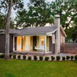 house plans for small homes trees grass porch pillars hanging bench windows roof traditional exterior