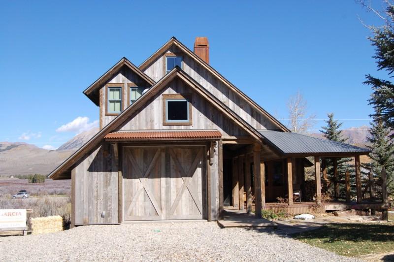 houses that look like barns door windows pillars plants scenery traditional exterior