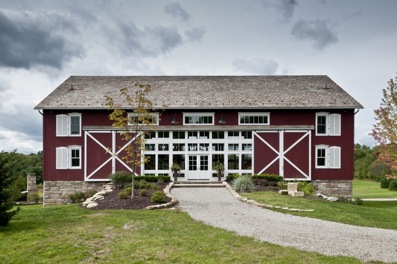 houses that look like barns grass stone red wall plants door windows roof farmhouse exterior