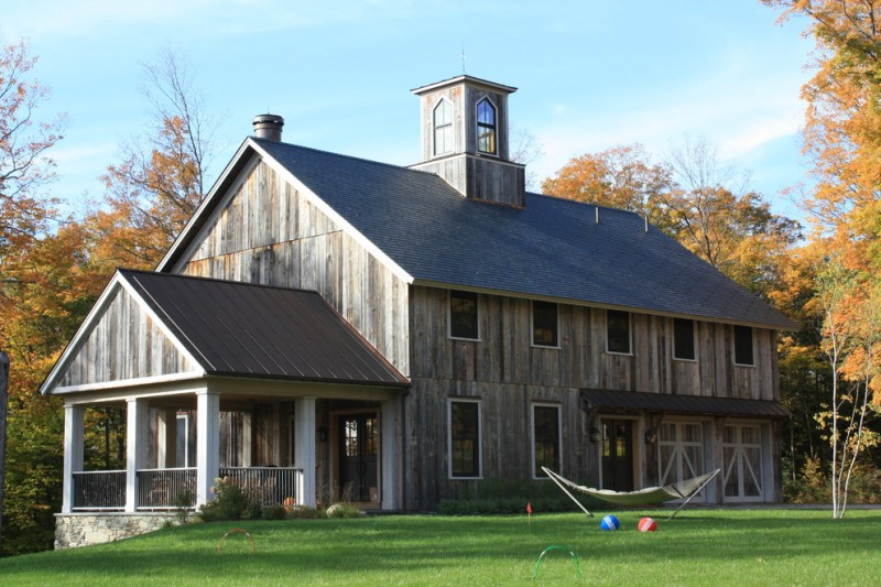houses that look like barns grass trees windows railing door roof rustic exterior