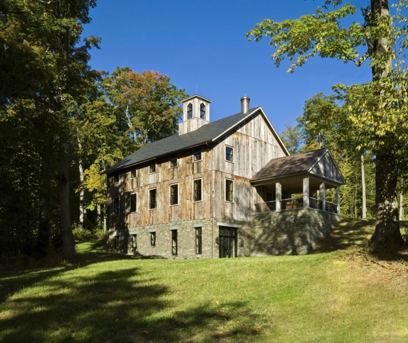 houses that look like barns grass trees windows railing pillars old looking rustic exterior