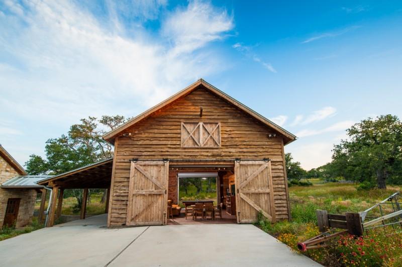 houses that look like barns sliding doors chairs table flowers farmhouse exterior