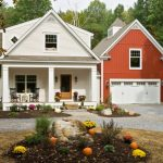 houses that look like barns windows door flowers outdoor area rocking chairs small table farmhouse exterior