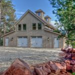 houses that look like barns windows doors roof trees rocks rustic exterior