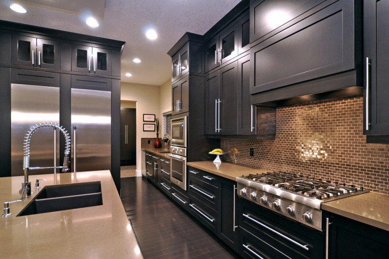 kitchen cabinets clearance island faucet sink stove ceiling lights dark floor backsplash contemporary room