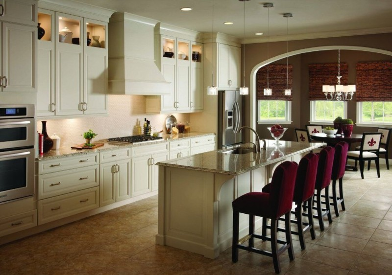 kitchen island with seating for 4 granite countertops porcelain floors recessed panel cabinet chairs sink round table pendants chandelier stainless steel appliances transitional design