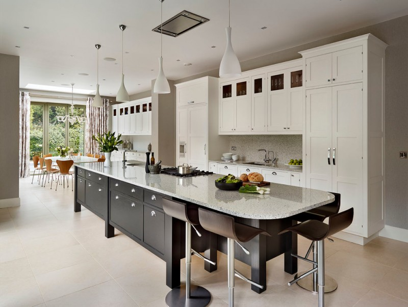 kitchen island with seating for 4 granite countertops white cabinets backsplash chairs pendants porcelain floors dining table ceiling lights undermount sink transitional design