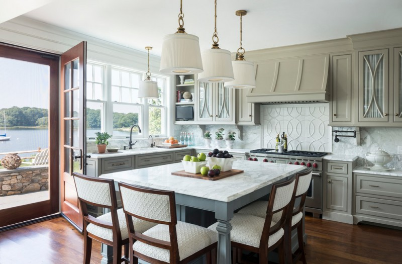 kitchen island with seating for 4 marble countertop hardwood floors undermount sink shaker cabinets white backsplash pendants chairs glass doors victorian design